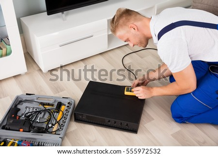 Technician Checking Broken Amplifier With Digital Multimeter