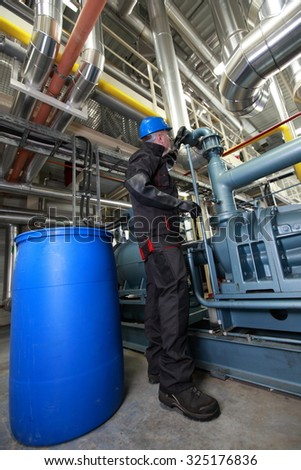 technician checking technological system - stock photo