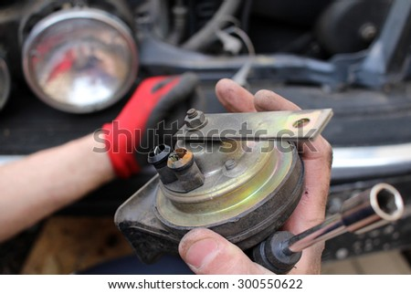 Technician fixing old broken car - stock photo