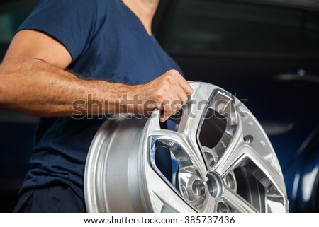 Technician Holding Alloy - stock photo