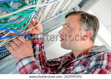 Technician in the server room - stock photo