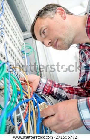 Technician in the server room - stock photo