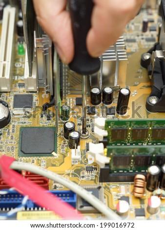 technician is repairing computer using screwdriver - stock photo