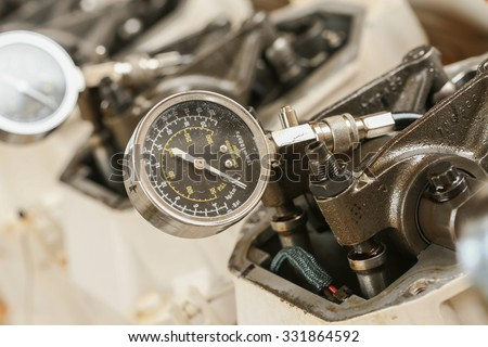 Technician performs adjusting Rocker arm of exhaust valve and intake valve, Pressure tested for cylinder of the engine. Checked clearance or gap between the end of valve and rocker arm. - stock photo