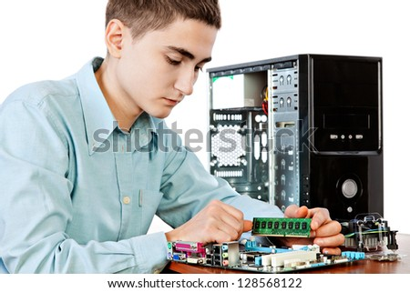 Technician repairing computer hardware in the lab.  Studio shot. Small DOF - stock photo