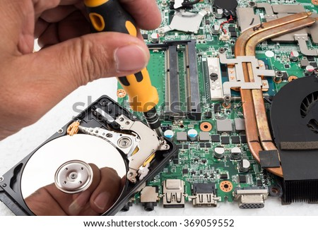 Technician support upgrade part and fixing laptop. select focus - stock photo