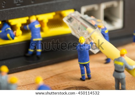 Technician team connect cable wire network to router - stock photo