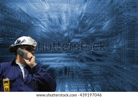 technician with a computers circuit-board in background, slight zoom effect - stock photo