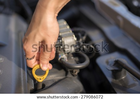 Technician woman working in auto repair