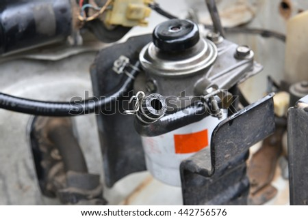 Technicians are repairing fuel lines and fuel filter . - stock photo