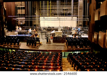 Technicians start to pack everything up at the end of the show. - stock photo