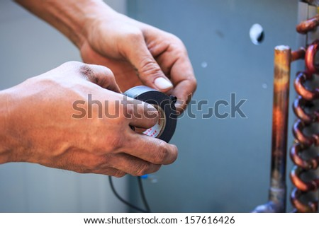 Technicians were repairing air-conditioning - stock photo