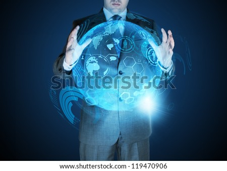 Technological Advances - A businessman holding a technical globe. - stock photo