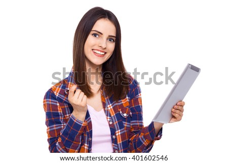 Technologies making life easier. Beautiful young woman holding digital tablet and looking at camera with smile while standing against white background - stock photo