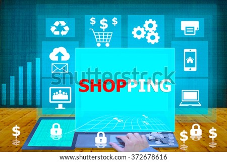 technology and biz concept. working on his laptop in the secured office, select icon shopping on the virtual display - stock photo