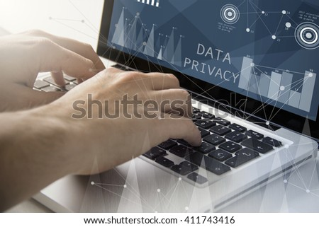 technology and business concept: man using a laptop with data privacy on the screen. All screen graphics are made up. - stock photo