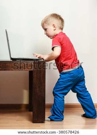 Technology and child. Preschooler boy playing on computer. Leisure, time of childhood.
