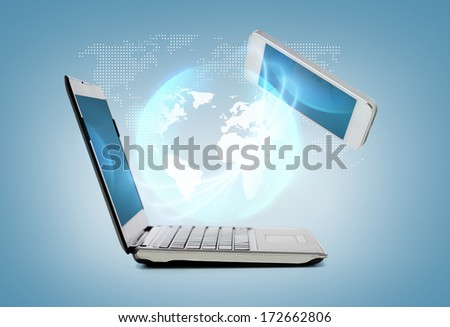 technology and internet concept - smartphone and laptop connecting - stock photo