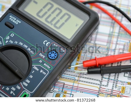 Technology background, digital multimeter - stock photo