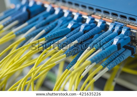 Technology center with fiber optic equipment patch core.(selective focus) - stock photo
