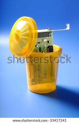 technology circuit on the trash, electronic tech metaphor - stock photo