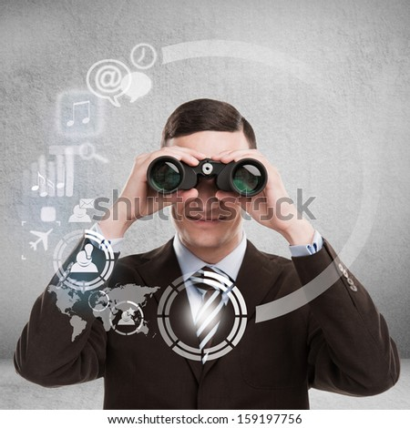 Technology concept. Businessman with binoculars and virtual interface with web and social media icons - stock photo