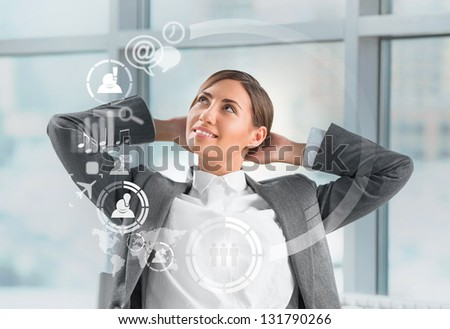 Technology concept. Businesswoman and virtual interface with web and social media icons - stock photo