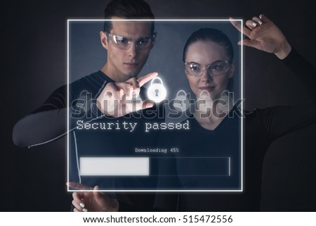 Technology, Internet and network futuristic security concept. Man and woman using virtual touchscreen with security lock