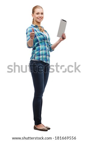 technology, internet and people concept - smiling girl with tablet pc computer showing thumbs up - stock photo