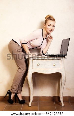 Technology internet modern lifestyle. Full length of young businesswoman woman student girl working on computer laptop at the retro desk. Business at home.