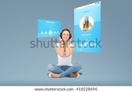 technology, music, multimedia and happiness concept - smiling young woman or teen girl in headphones over media player screen and blue background