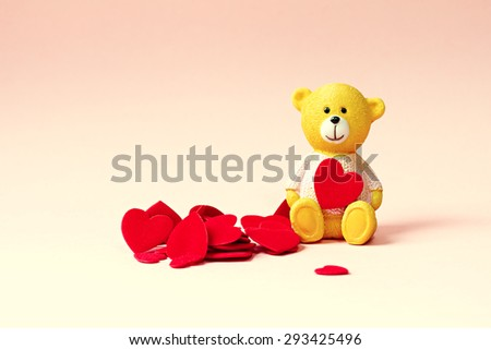 Teddy bear and hearts on pale pink background vanilla. Background for wedding cards and valentines with space for text. - stock photo