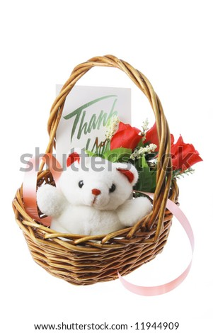 Teddy Bear and Red Roses in Basket - stock photo