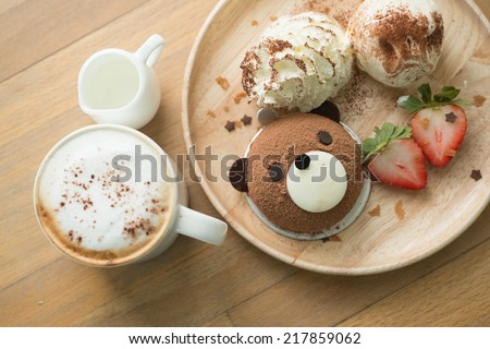 Teddy bear chocolate cake with coffee - stock photo