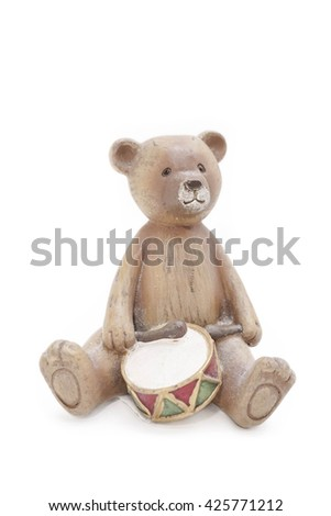 Teddy Bear craft wooden doll, isolated on white background, drummer or musician bear