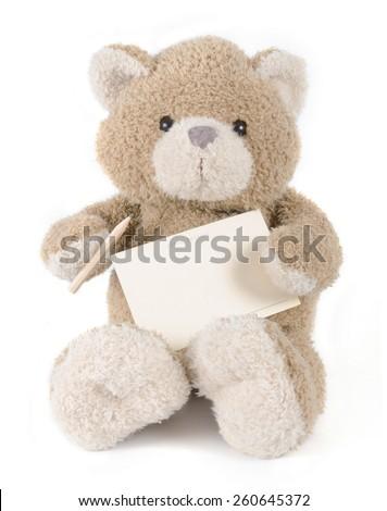 Teddy bear holding greeting card - stock photo
