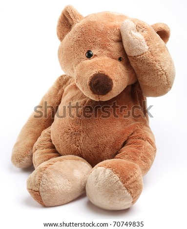 Teddy bear in a worry. Isolated over white. - stock photo