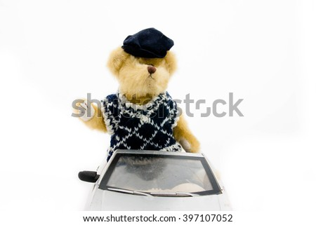 Teddy bear in toy car on white background - stock photo