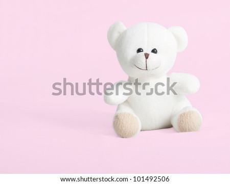 teddy bear isolated on pink - stock photo