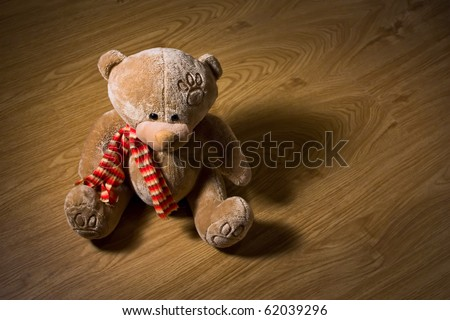 Teddy bear on wood floor - stock photo