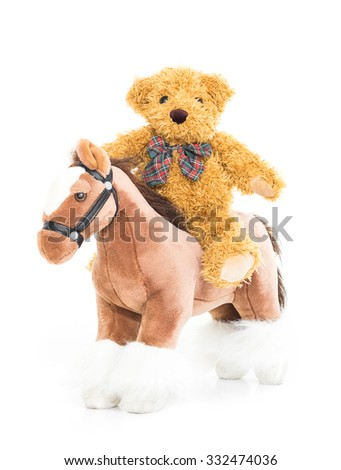 Teddy bear riding a horses on white background - stock photo