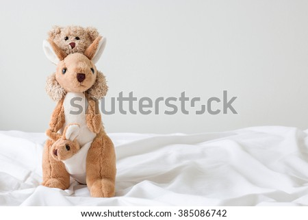 teddy bear riding  kangaroo  ( good feeling ) - stock photo