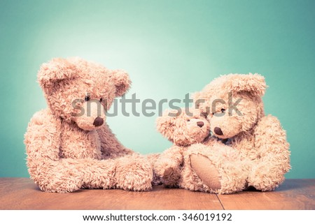 Teddy Bear's toy family concept. Retro old style filtered photo - stock photo