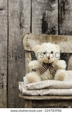 Teddy bear siting on chair