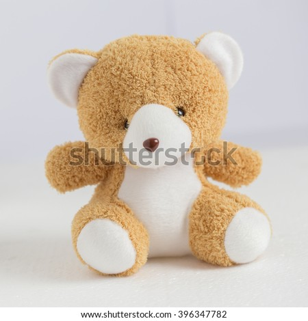 Teddy Bear sitting on the white floor - stock photo