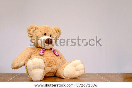 Teddy Bear toy alone on wood - stock photo