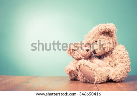 Teddy Bear toy mother with baby concept. Retro old style filtered photo - stock photo