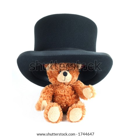 Teddy bear wearing a big bowler hat - stock photo