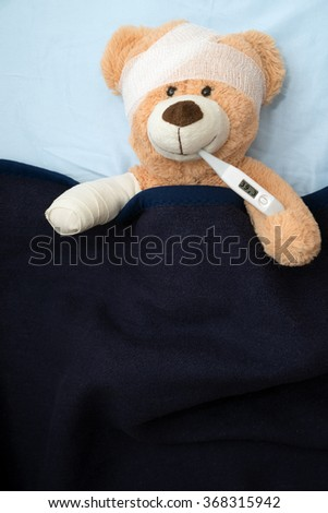 Teddy Bear with Bandage and Clinical Thermometer / sick Teddy - stock photo