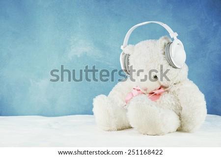 teddy bear with headphone - stock photo